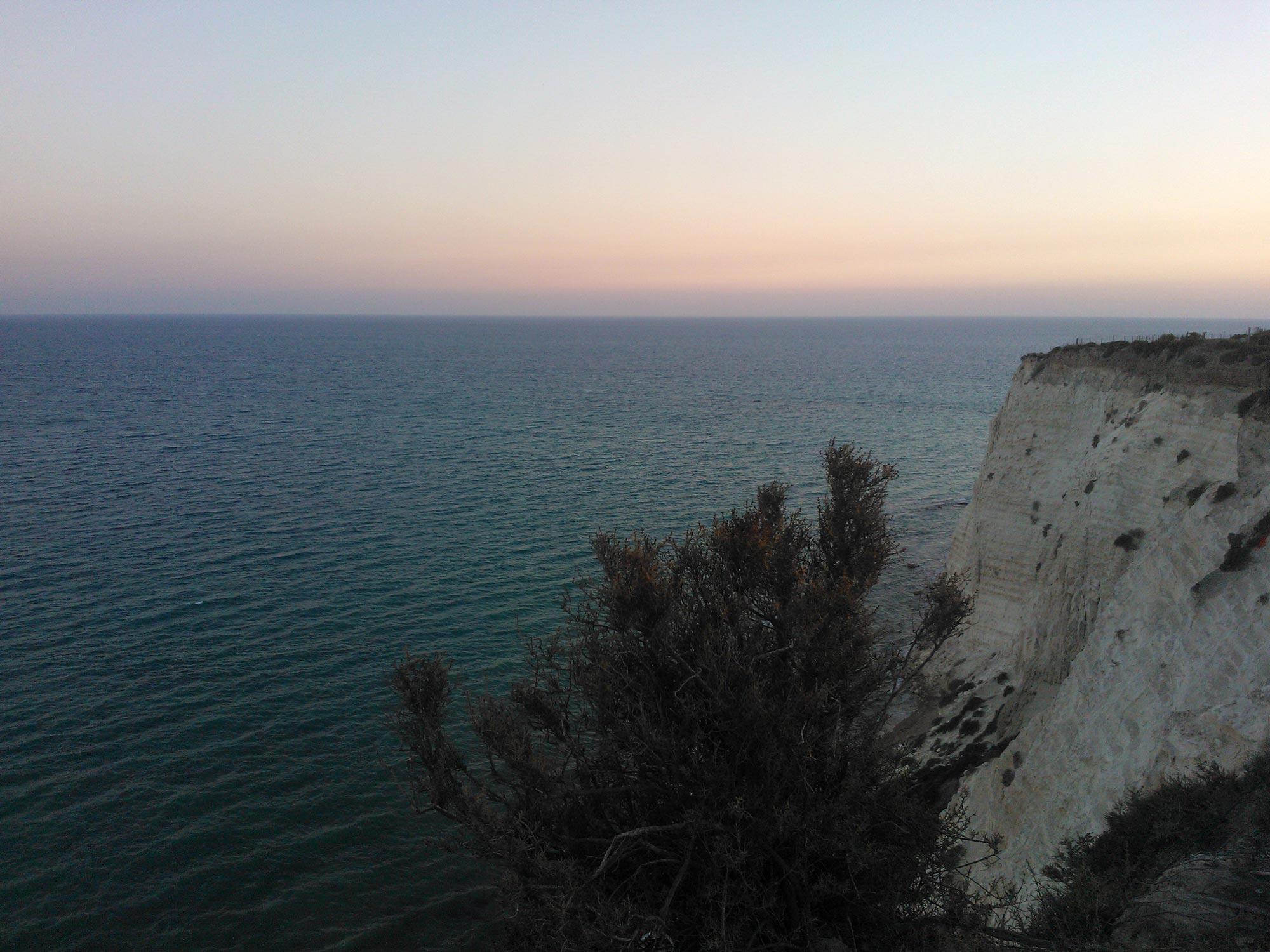 Sicily coast cliff sunset