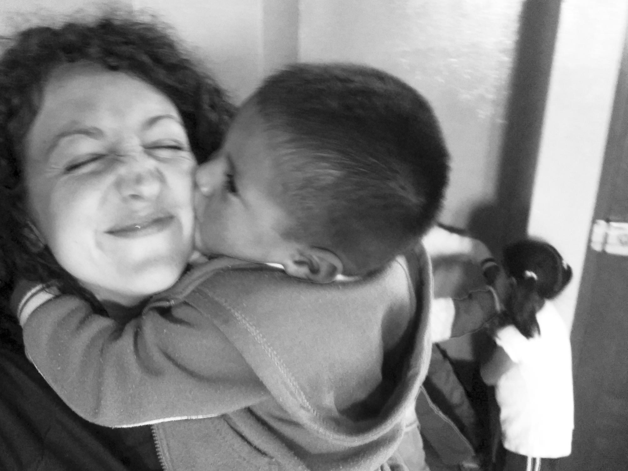 Peru Ayacucho Puericultorio kiss and hug from a kid