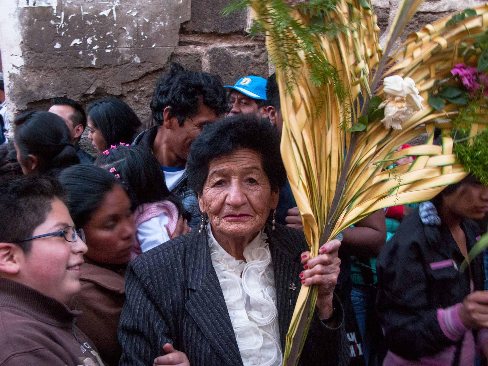 Peru Ayacucho Semana Santa woman holding a palm