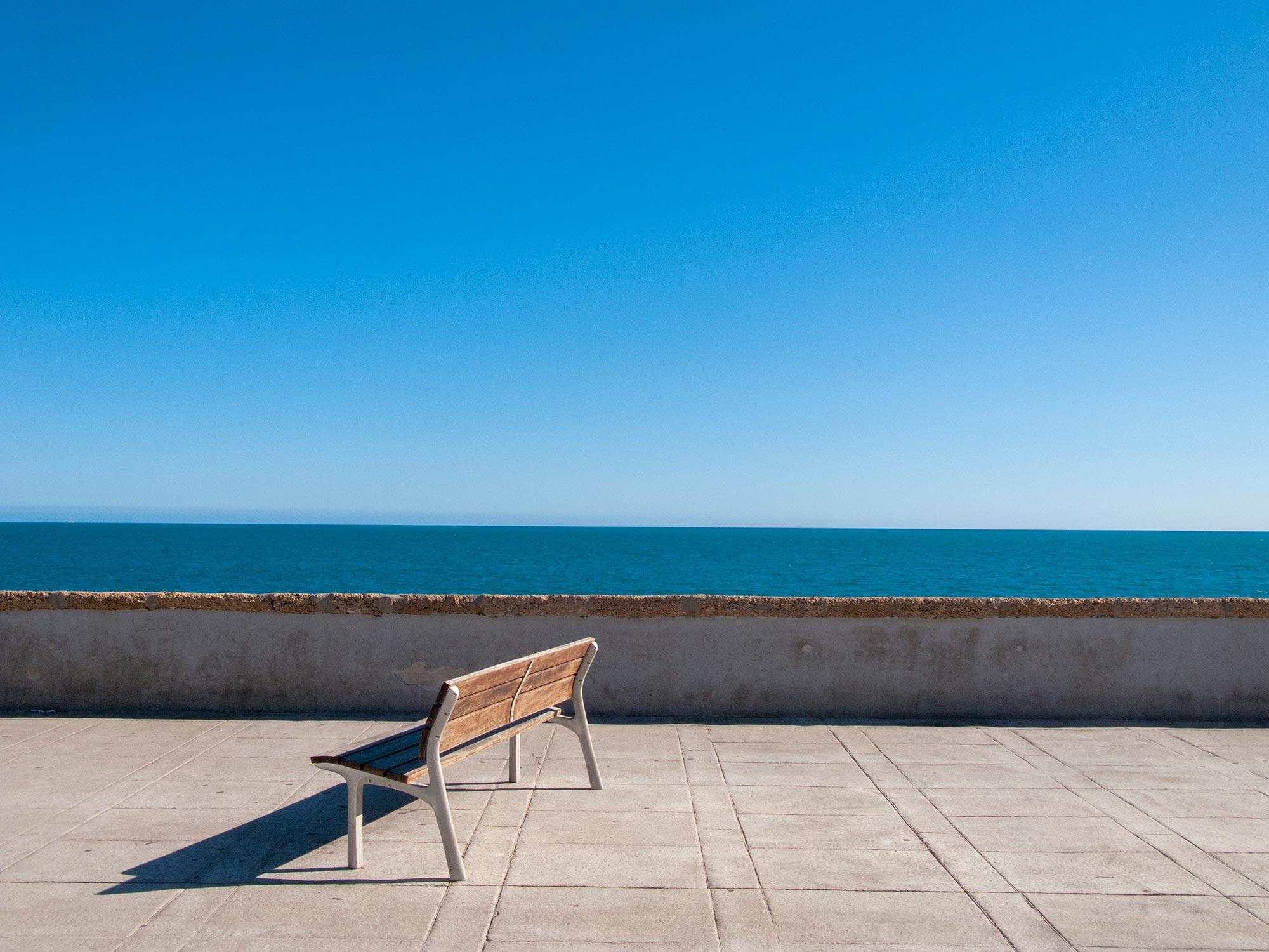 Cadiz a bench looking at the ocean