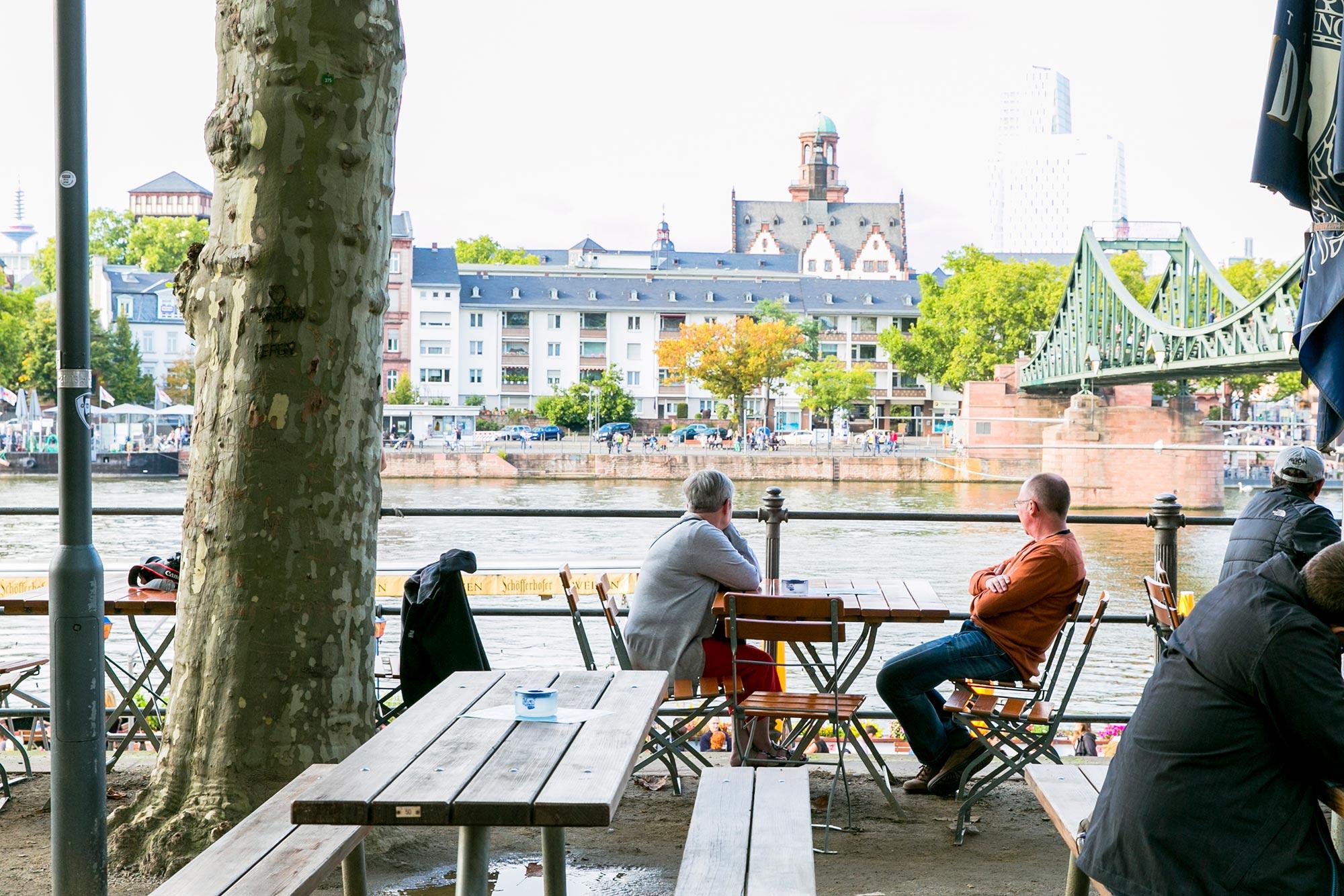 café on main river banks frankfurt